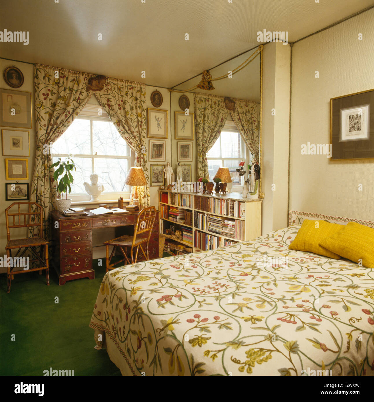 Crewelwork bedcover and curtains in eighties study bedroom - Stock Image