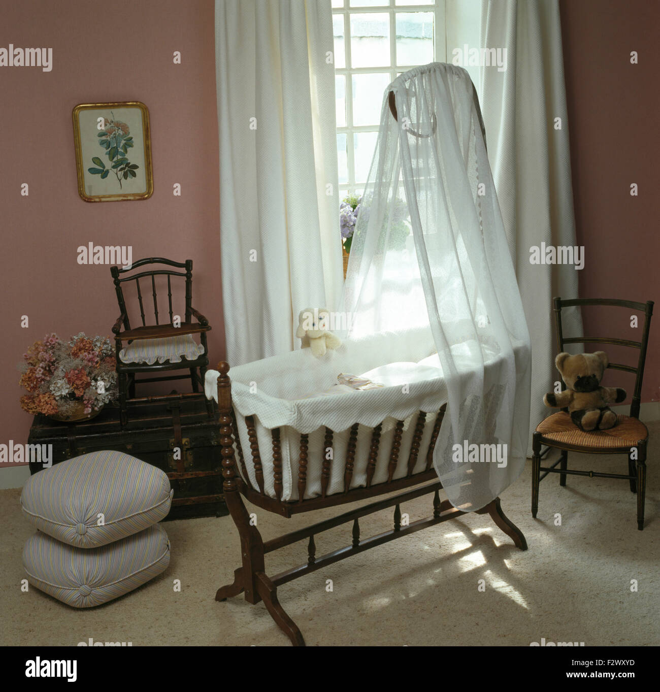 White Voile Drapes On A Victorian Style Rocking Cradle In Eighties