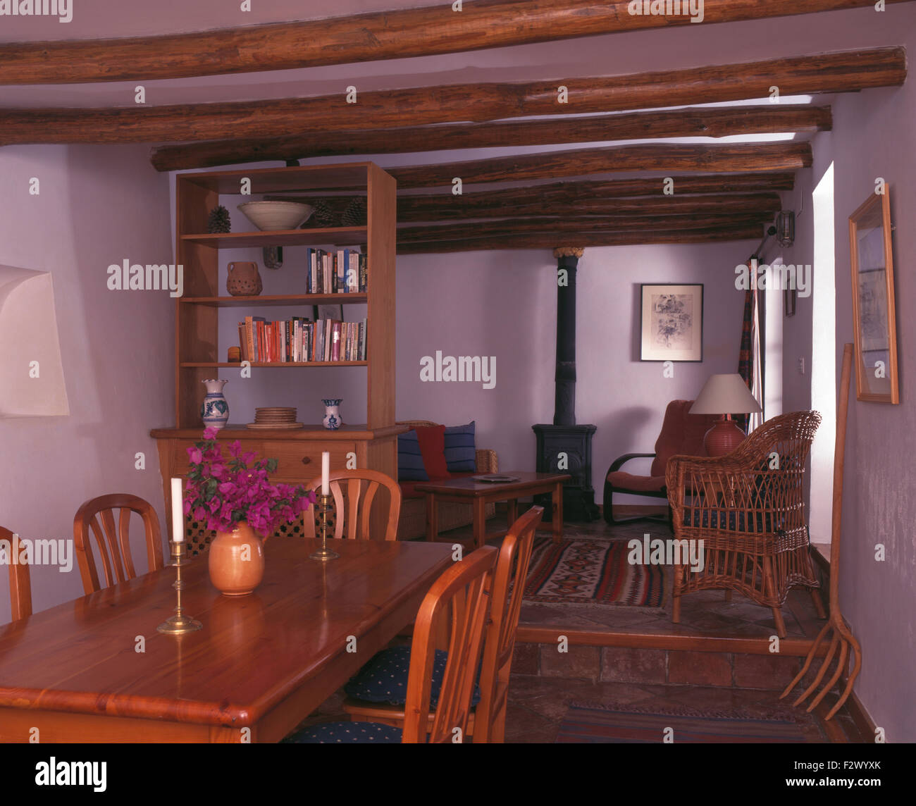 https://c8.alamy.com/comp/F2WYXK/wooden-chairs-and-table-in-spanish-cottage-dining-room-with-a-wood-F2WYXK.jpg