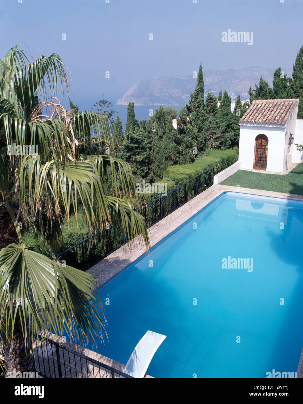 Birdseye view of turquoise swimming pool in grounds of Spanish villa - Stock Image