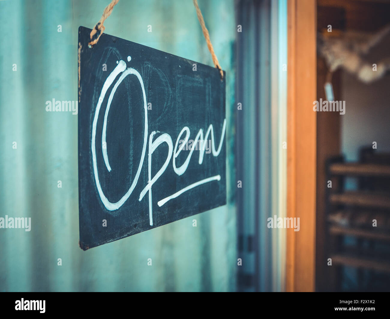 Rustic Open Sign Hanging In The Door Of A Coffee And Gift Shop In The Pacific Northwest Stock Photo