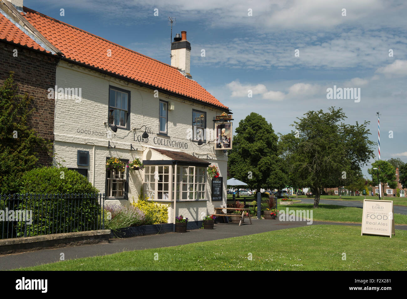Sunny summer view of attractive, traditional, old, English rural pub (The Lord Collingwood) - Upper Poppleton village Stock Photo