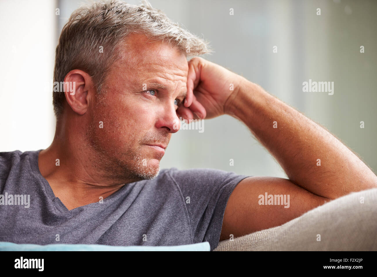 Mature Man Suffering From Depression At Home - Stock Image