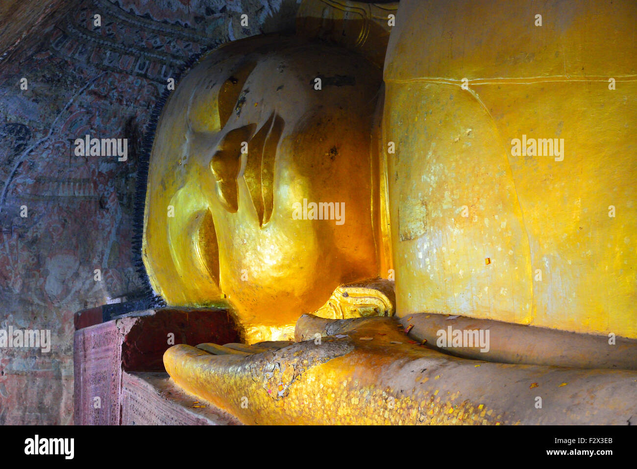 Gold head of giant lying buddha at the Hpo Win Daung cave complex also known as Pho Win Taung caves, Upper Burma, Myanmar (formerly Burma) Stock Photo