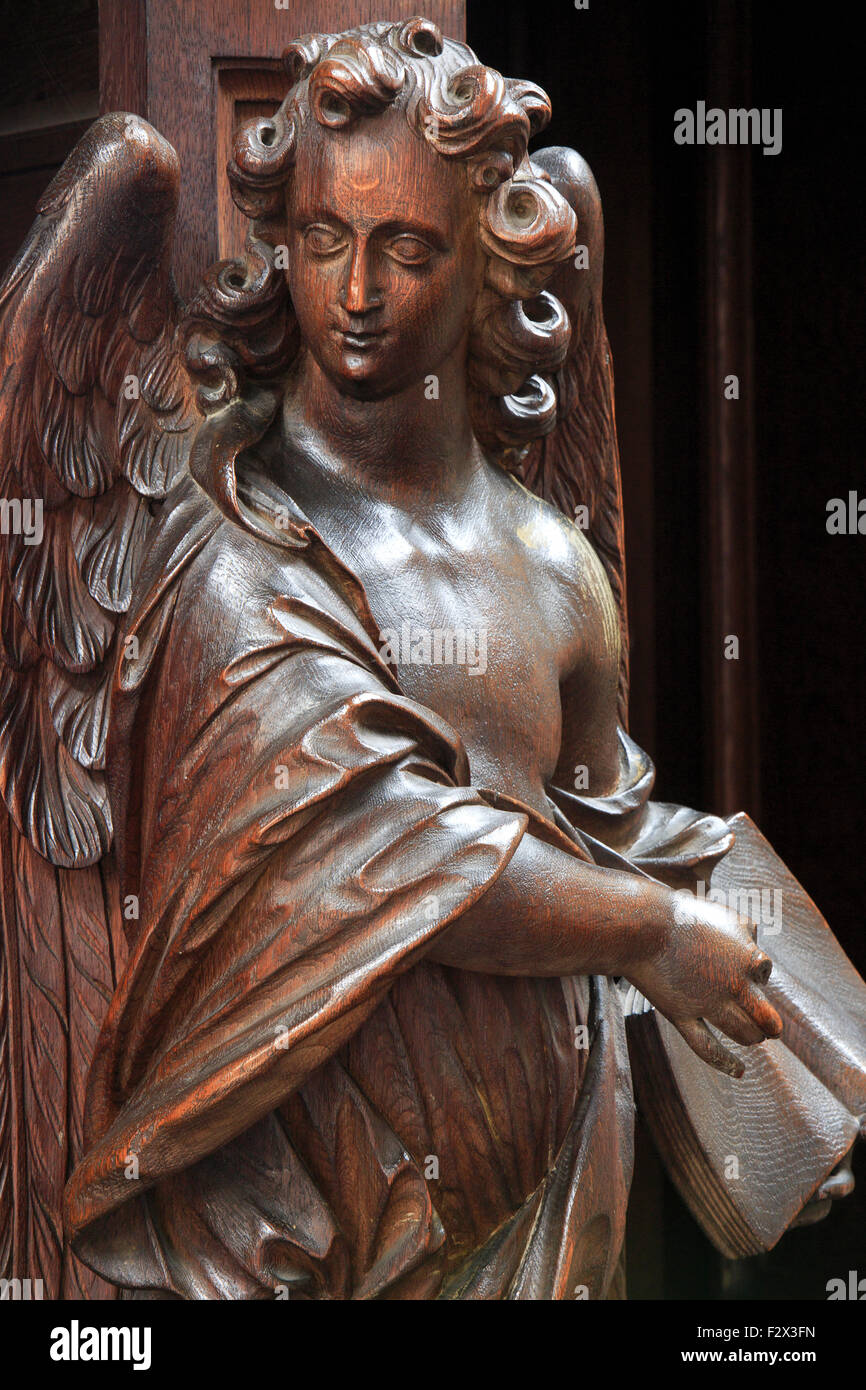 Wood carved statue of an angel outside a confessional box of the St John's Church in Mechelen, Belgium - Stock Image