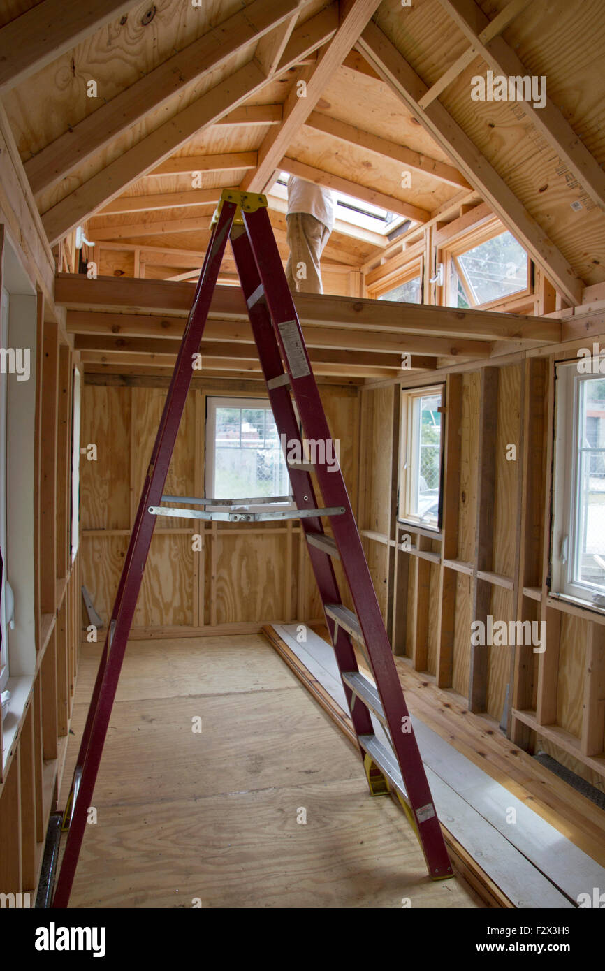 The Wood Interior Of An 18 Foot Long Tiny House With Sleeping Loft In The  Process Of Being Built