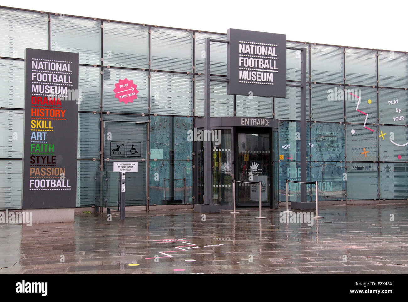 National Football Museum at Manchester in the rain. - Stock Image