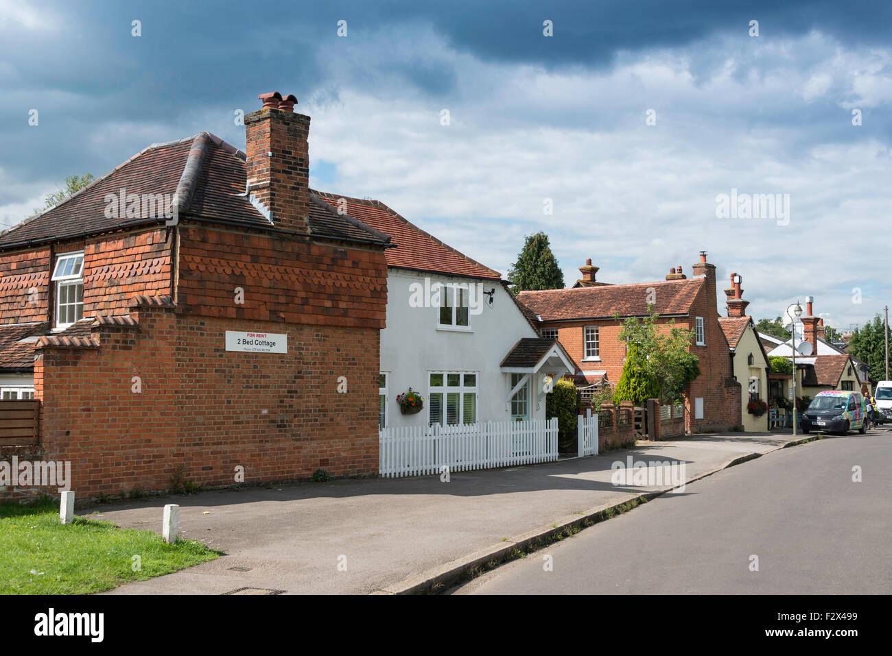 Cottages and Running Mare Freehouse Pub & Restaurant, Tilt Green, Cobham, Surrey, England, United Kingdom - Stock Image