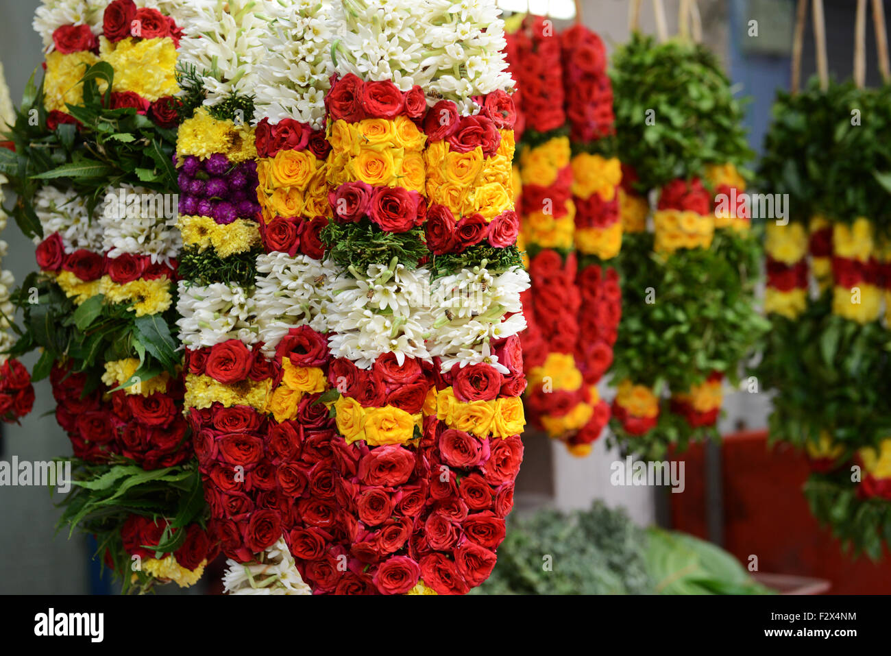 Flower garments sold near a hindu temple in Little India, Singapore. - Stock Image