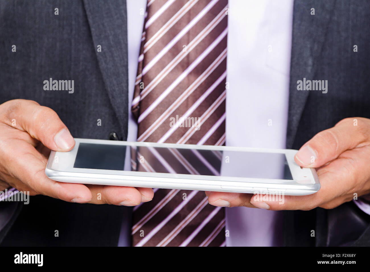 1 Business man Digital Tablet Technology - Stock Image