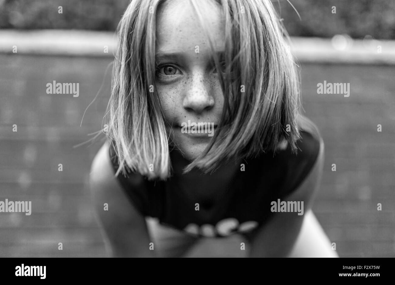 Portrait of interested girl - Stock Image