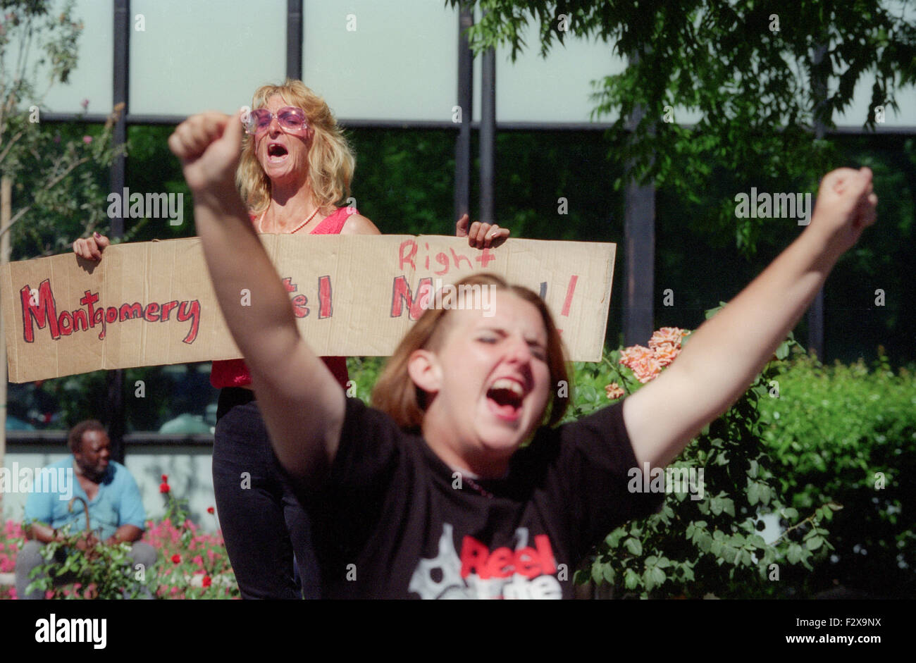 two women shouting, one is holding sign reading, Montgomery Hotel Now!  San Jose homeless, low income residents, - Stock Image