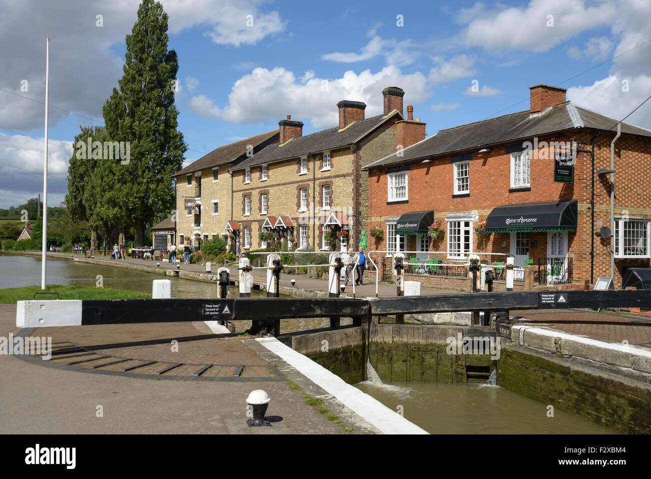 The top lock of the Stoke Bruerne flight, Stoke Bruerne, Northamptonshire, England, United Kingdom - Stock Image