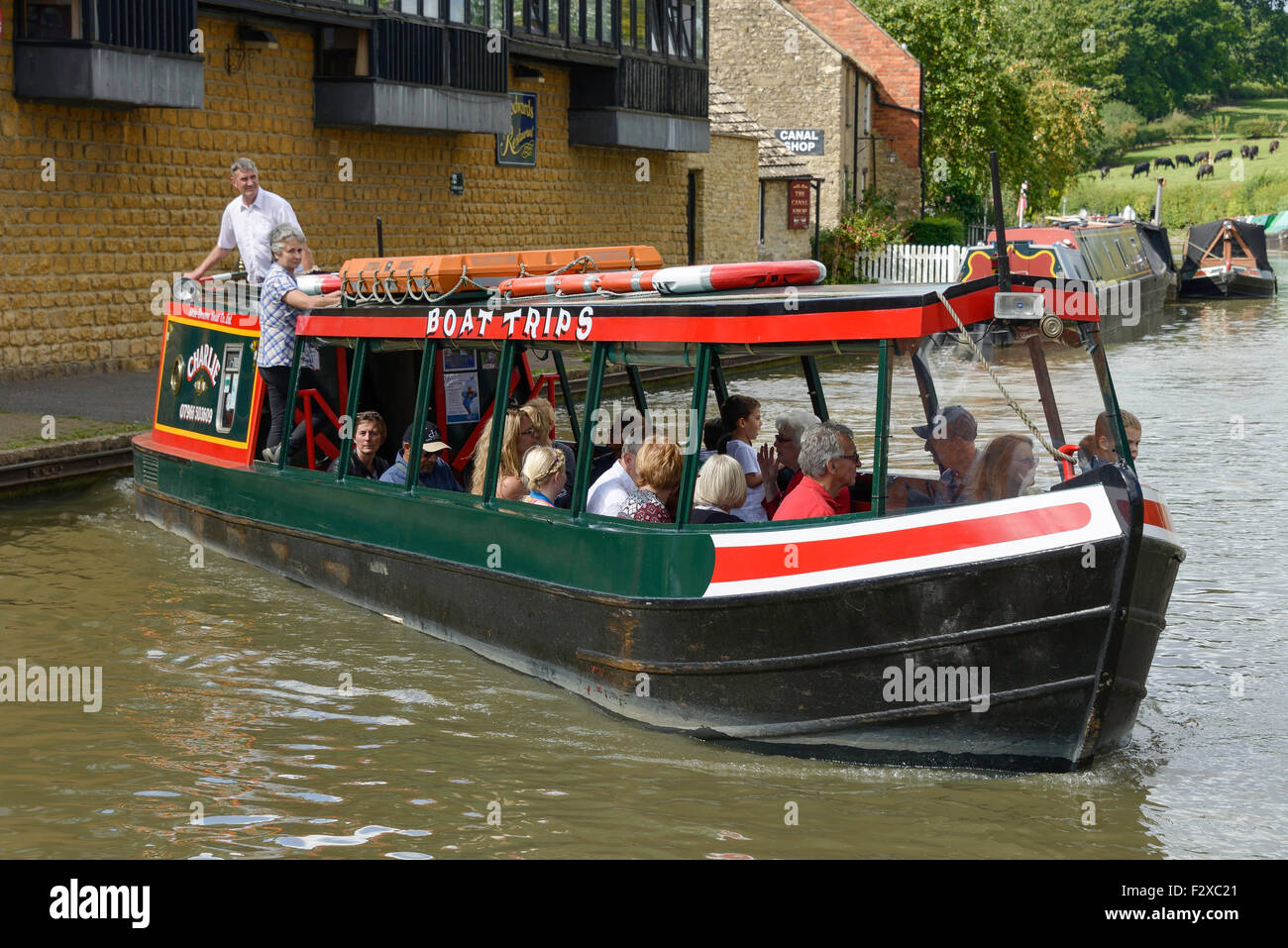Cruise boat on Grand Union Canal, Stoke Bruerne, Northamptonshire, England, United Kingdom - Stock Image