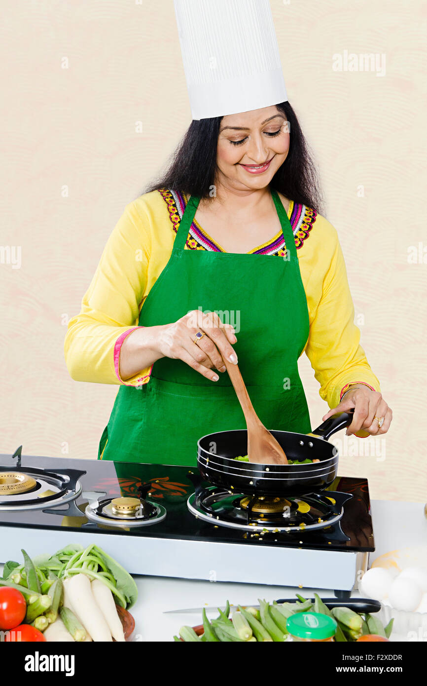 https://c8.alamy.com/comp/F2XDDR/1-indian-adult-woman-housewife-kitchen-cooking-F2XDDR.jpg Indian Woman Cooking