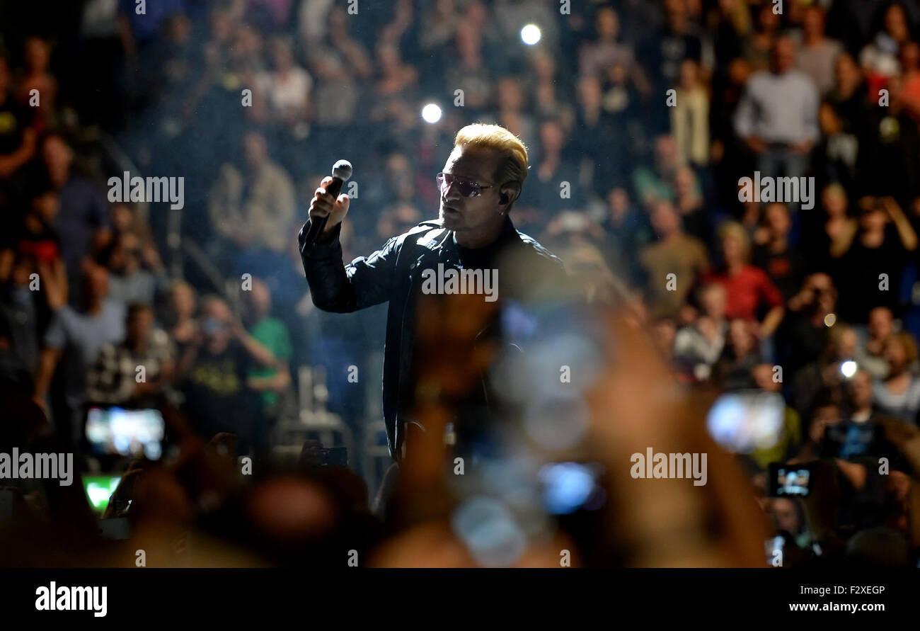 Berlin, Germany. 24th Sep, 2015. Singer Bono (Paul David Hewson) of Irish rock band U2 performs on stage during - Stock Image