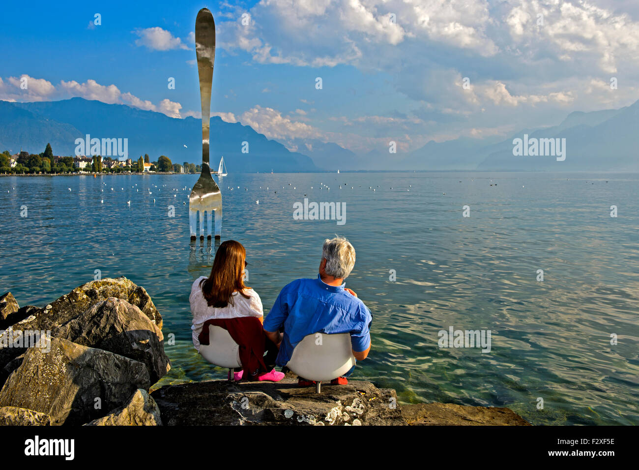 Visitors at the sculpture, The Fork, La Fourchette, by Jean-Pierre Zaugg, in Lake Geneva, Museum of Nutrition Alimentarium - Stock Image