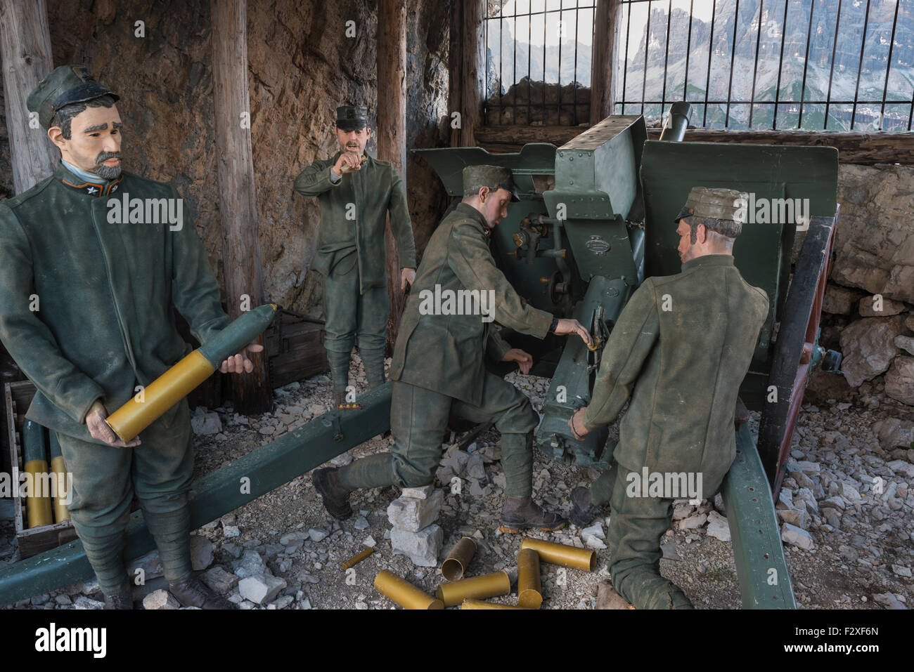 WWI outdoor museum, soldiers firing grenades, Five Towers, Falzarego Pass, Dolomites, Veneto, Italy - Stock Image