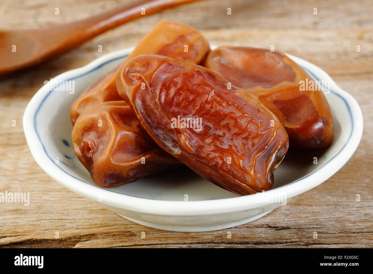 Date fruits in bowl - Stock Image