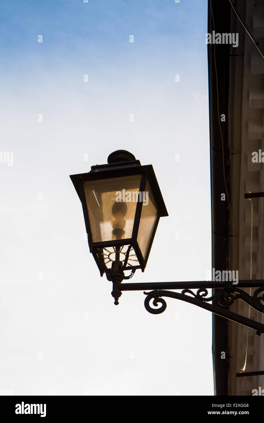 Old Lantern Lit Isolated On Sky Background