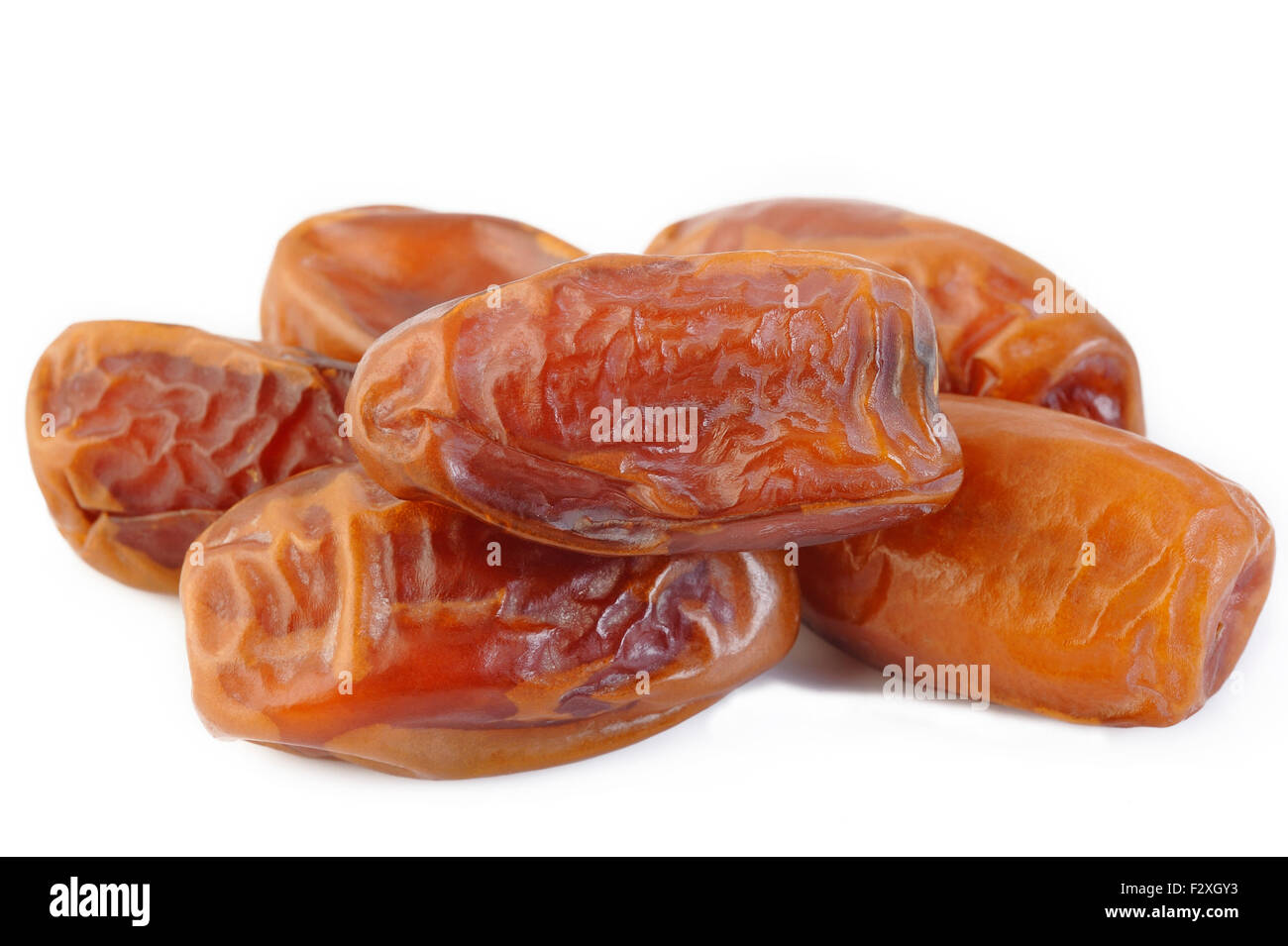 Dried dates isolated on white background - Stock Image