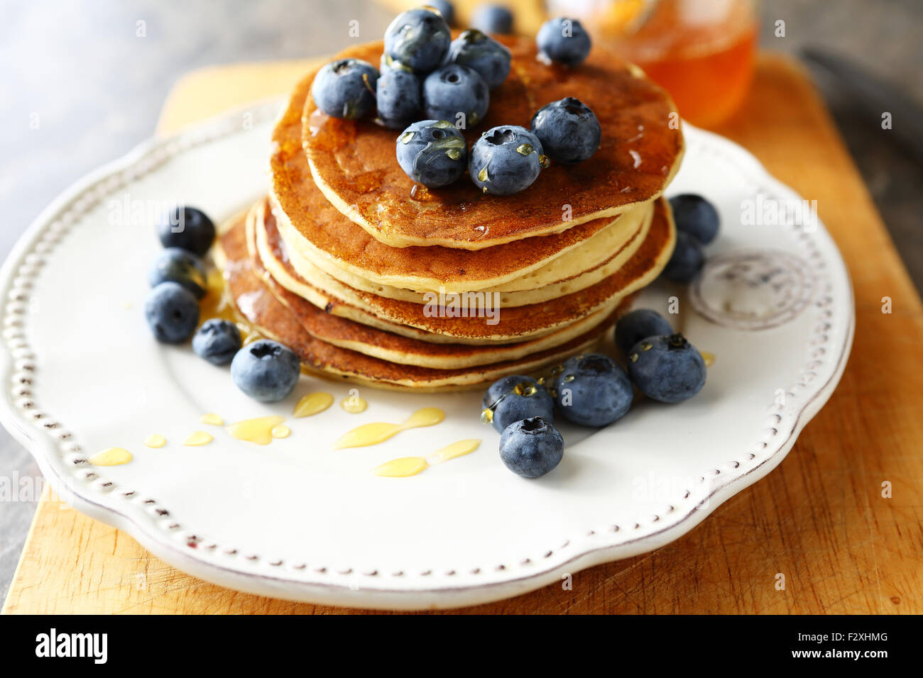 american pancakes with syrup on plate - Stock Image