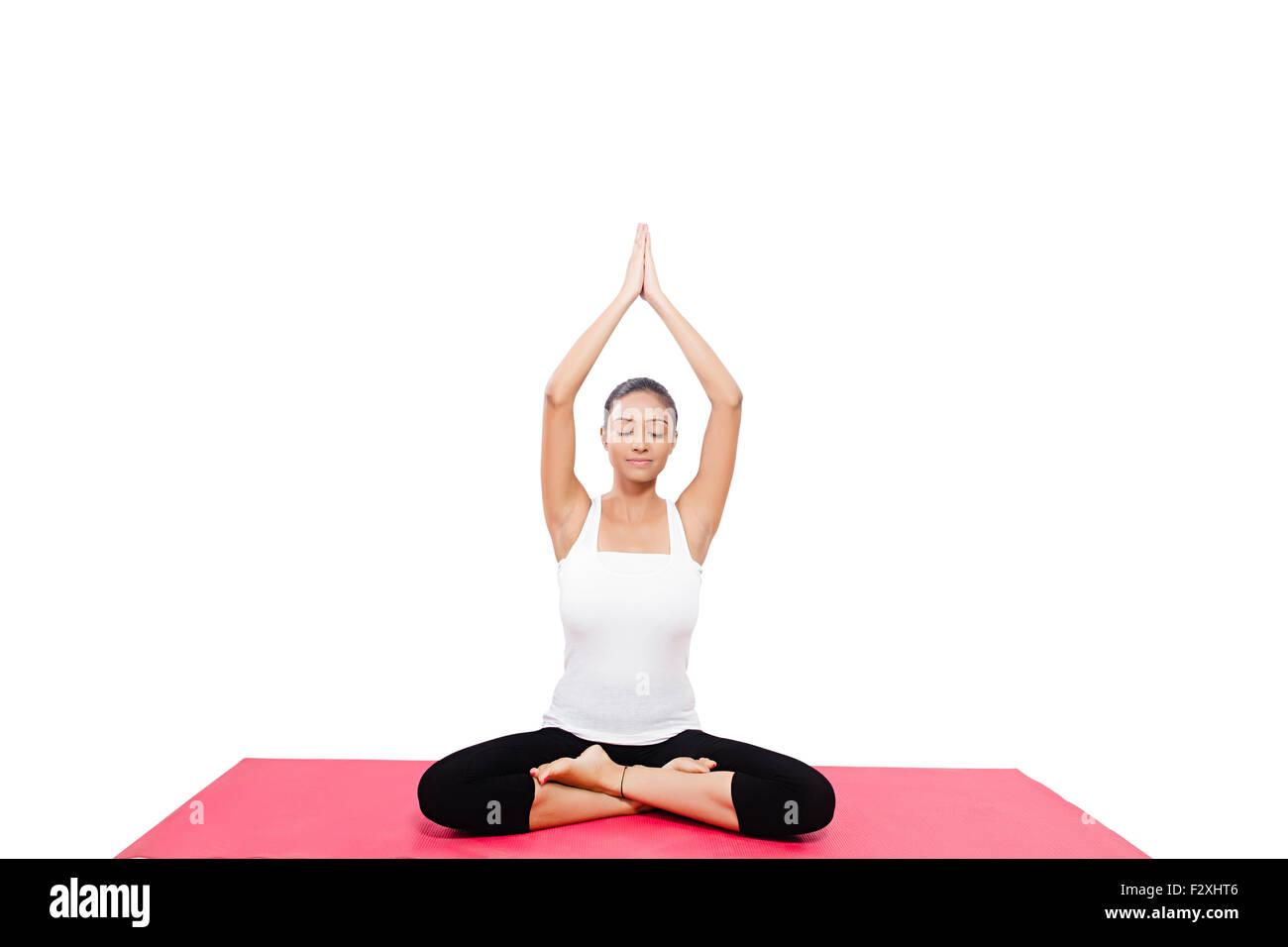 1 indian Adult Woman Yoga Surya Namaskar - Stock Image