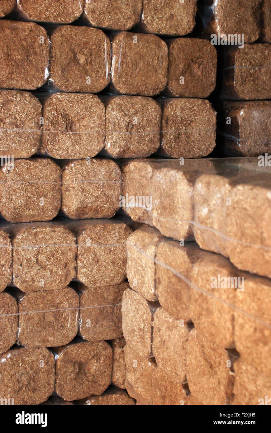Hard wood briks for heating - Stock Image