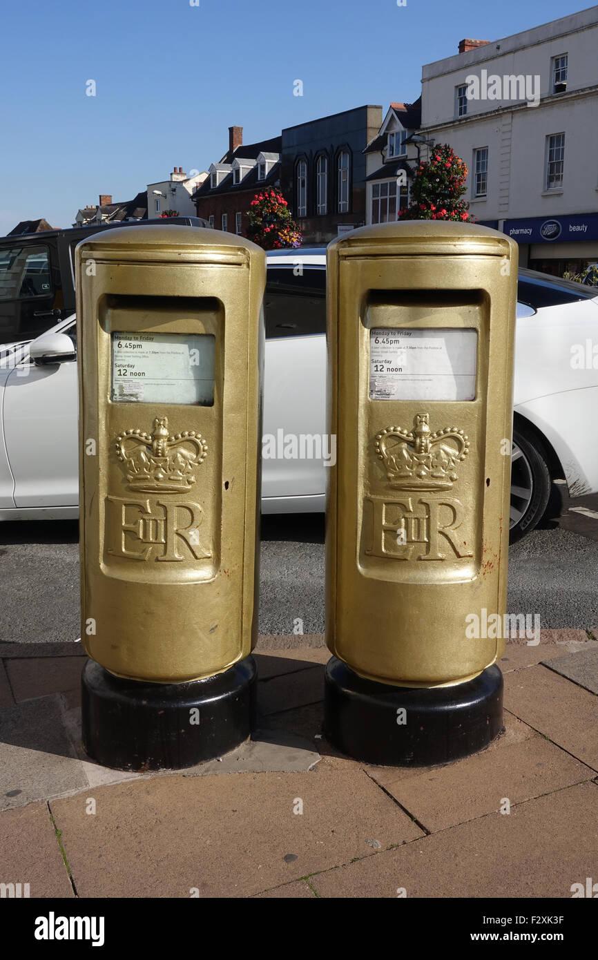 Gold Pillar Boxes at Stratford Upon Avon, Warwickshire -1 - Stock Image