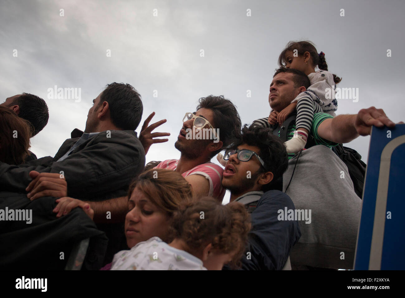 Refugees, waiting to cross into the Schengen zone at Rigonce, Slovenia. - Stock Image