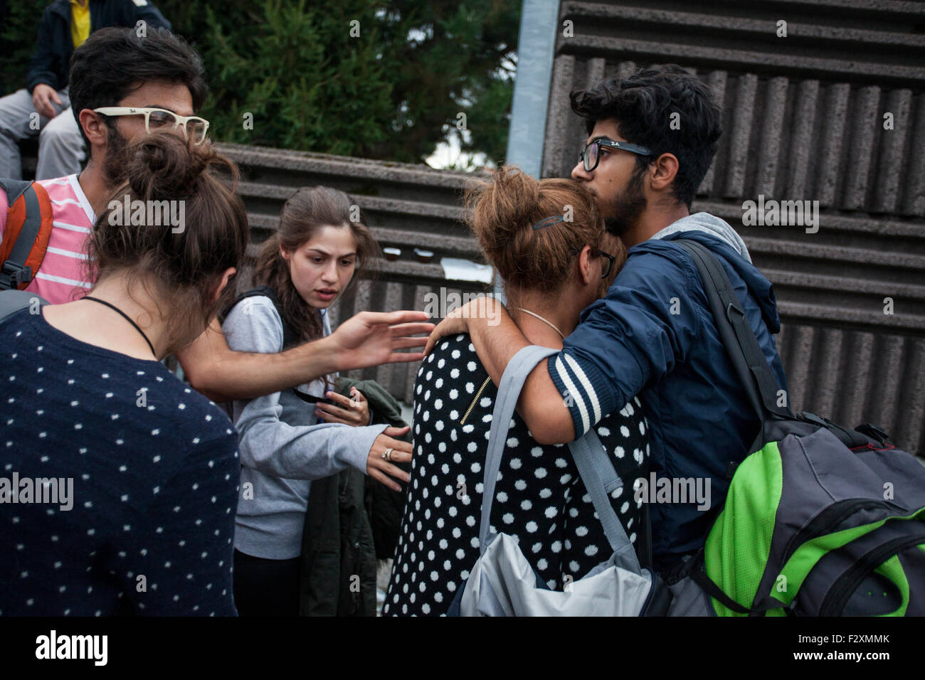 Syrian family reunited after crossing the border and entering Schengen zone at Rigonce, Slovenia - Stock Image