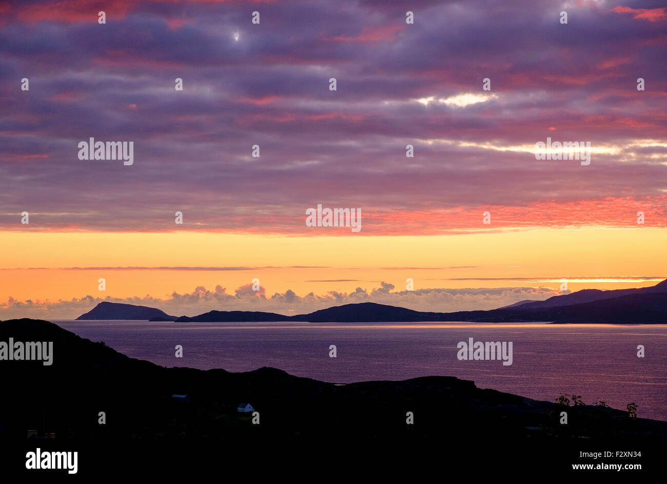 sunset beara peninsula ireland clouds headland sky - Stock Image