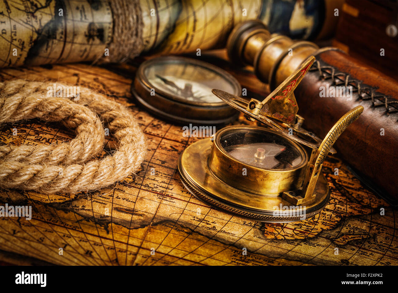 Old vintage compass on ancient map - Stock Image