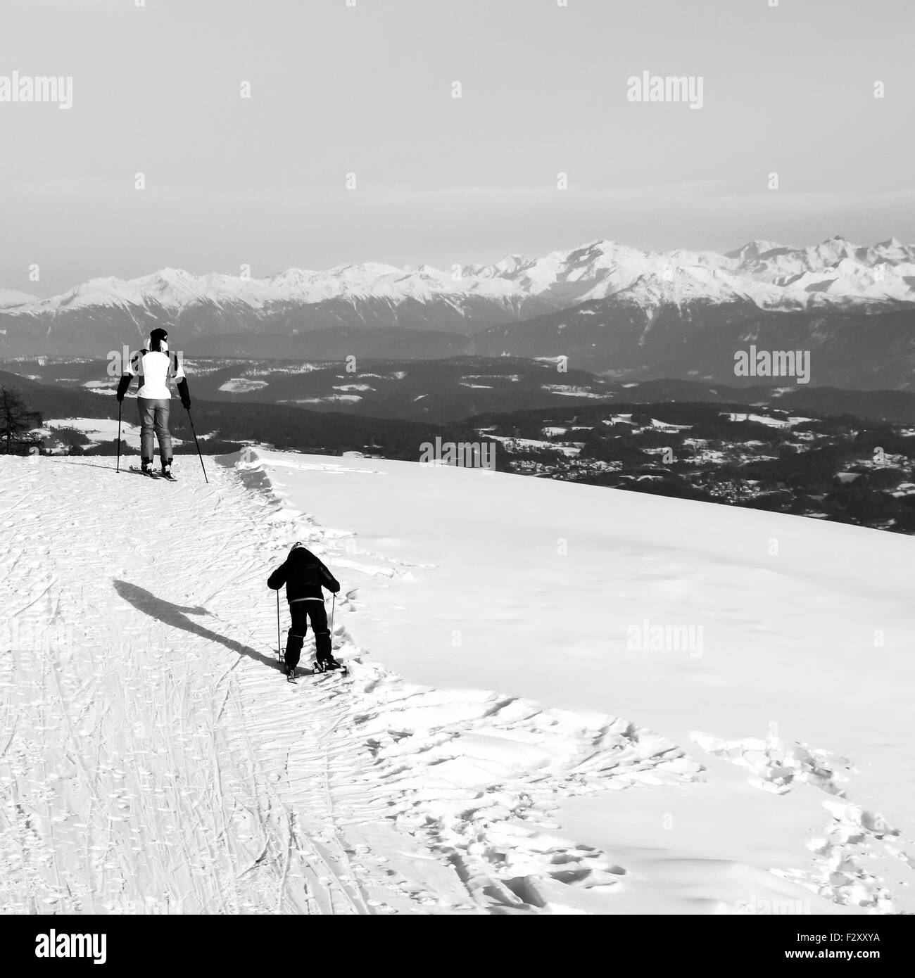 ORTISEI, ITALY - CIRCA DECEMBER 2012: Father and son skiing on the snowy slopes of the Alps. - Stock Image