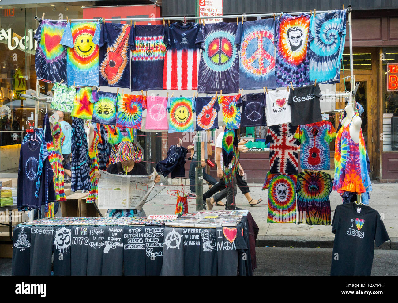 A vendor selling 70 and 80's themed tee shirts and other merchandise at a street fair in New York on Saturday, - Stock Image
