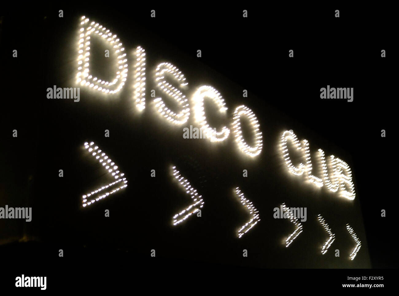 Neon sign disco club black and white shimmer - Stock Image
