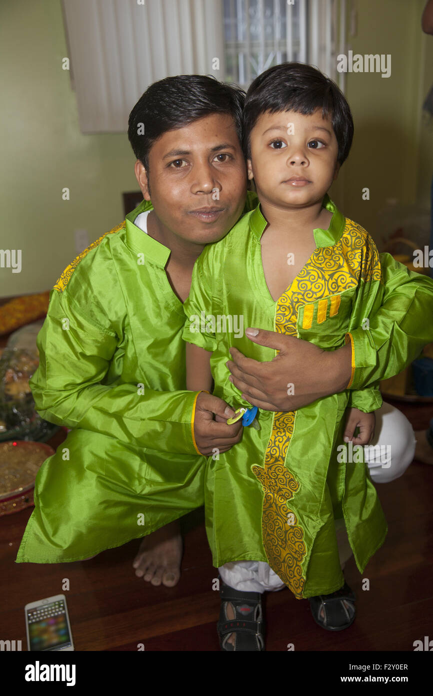 Portrait of father and young son, Bangladeshi American. - Stock Image