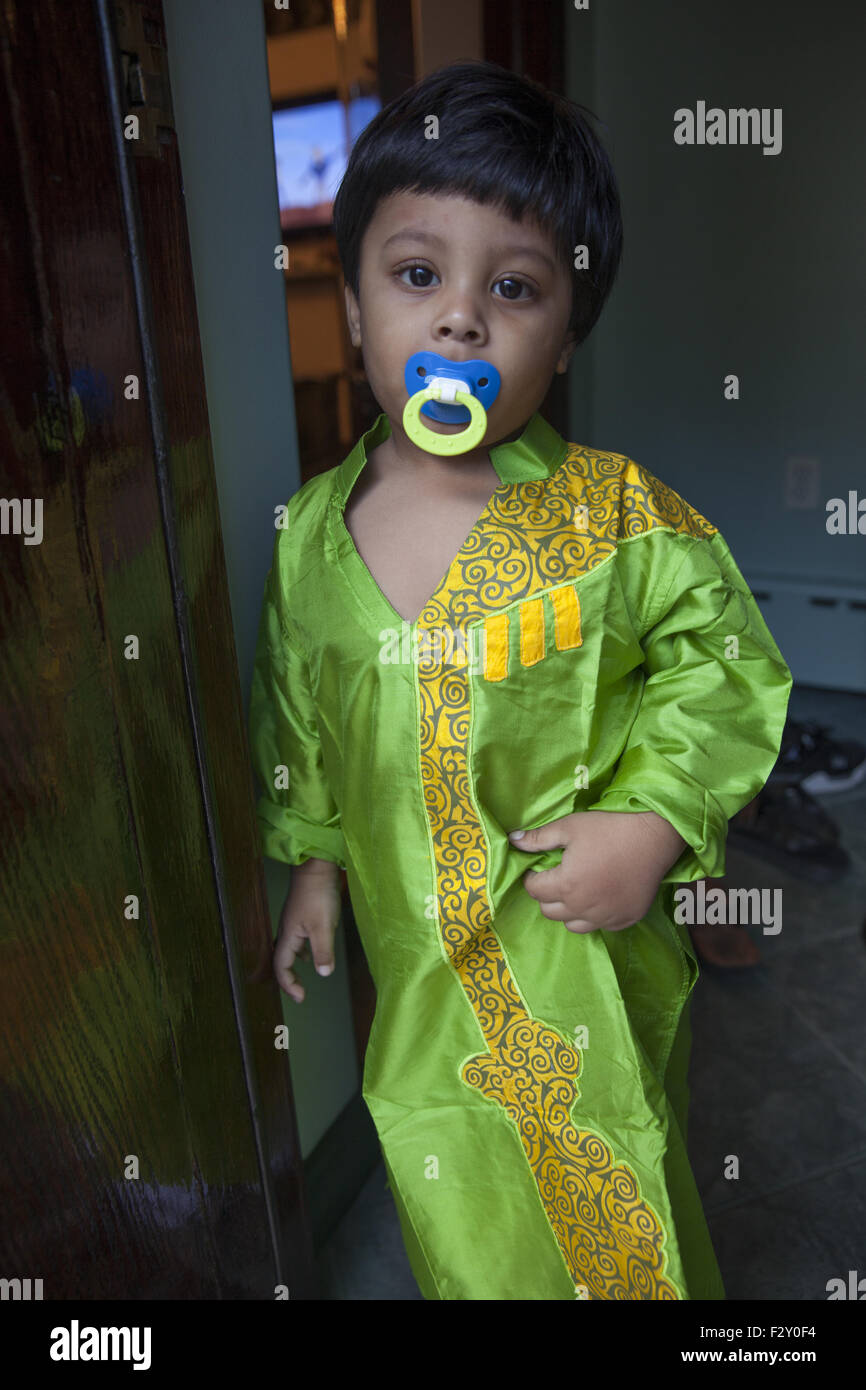 Bangladeshi American child dressed to attend his uncle's wedding in Brooklyn, NY - Stock Image