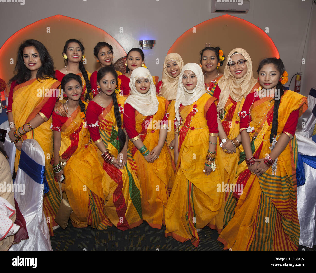 Female family & friends of the bride at a Bangladeshi wedding in Brooklyn, NY. - Stock Image