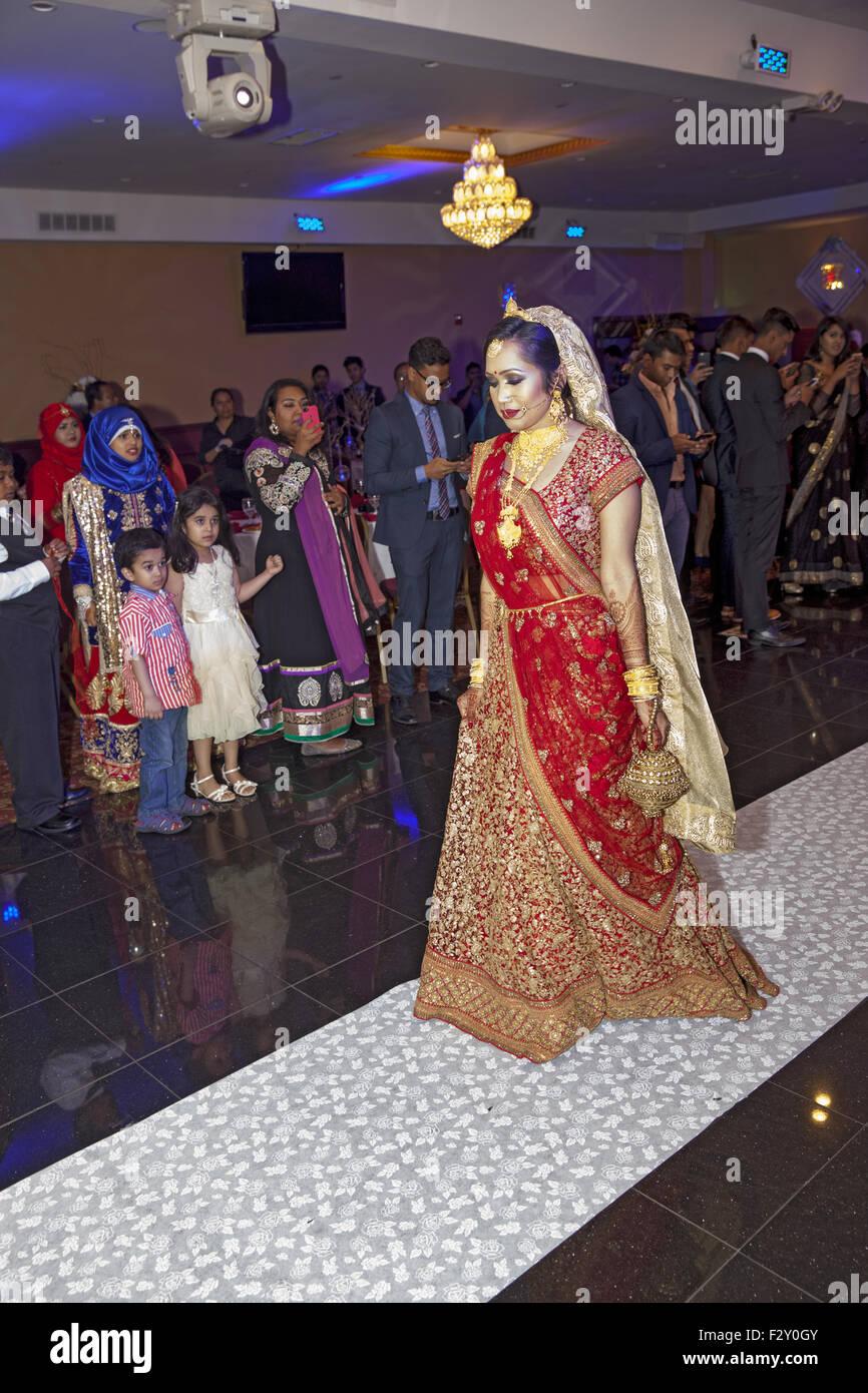 Bangladeshi Muslim bride enters the wedding reception hall in Brooklyn, NY. - Stock Image