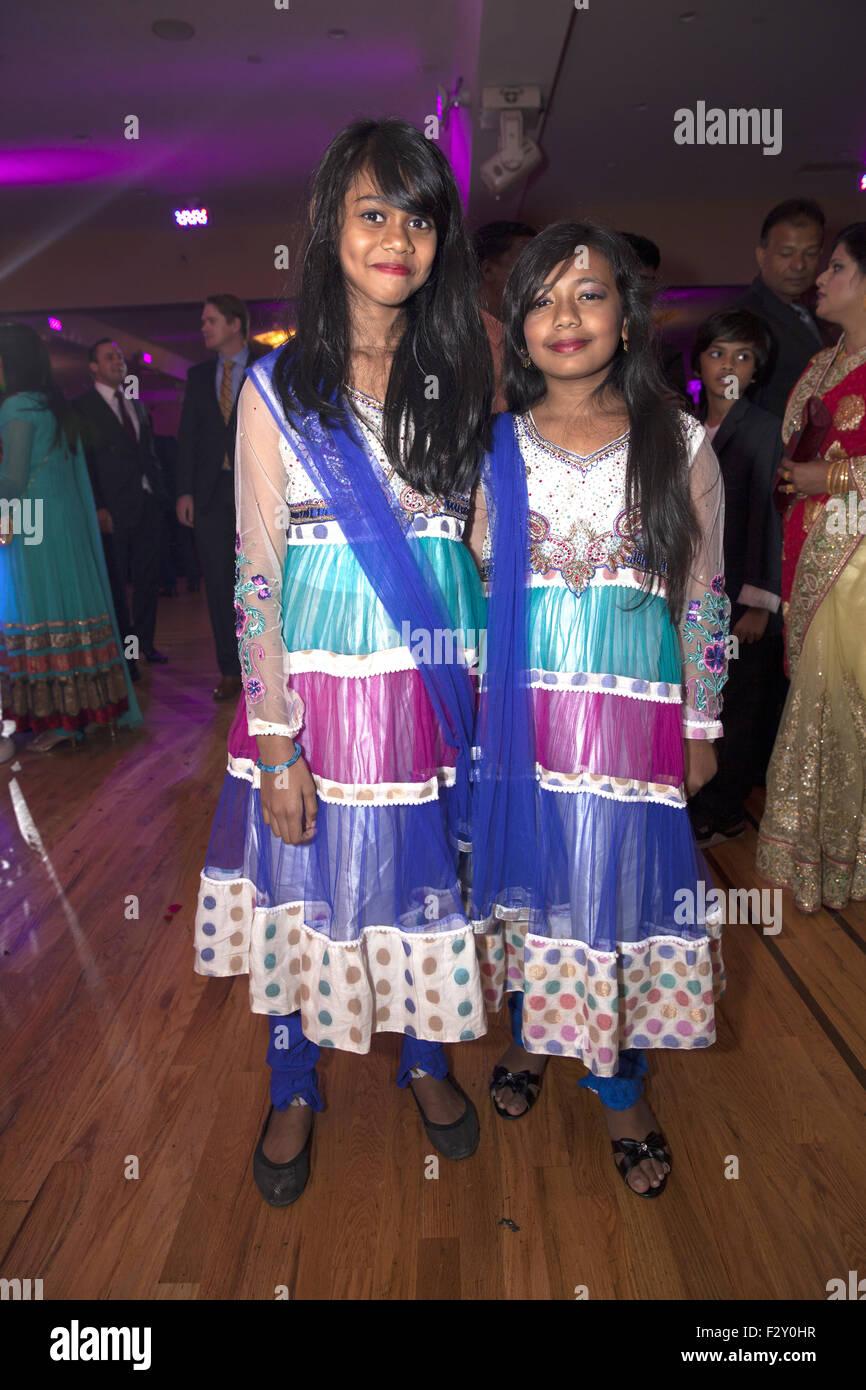 Bangladeshi sisters at a wedding in Brooklyn, NY. - Stock Image