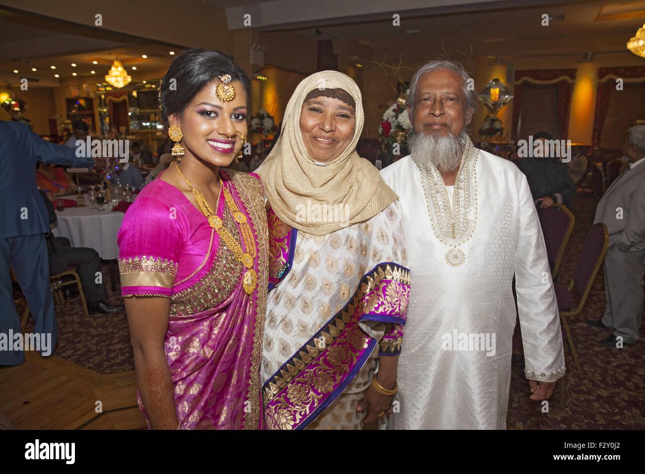 Guests at a Bangladeshi Muslim wedding reception, Brooklyn, NY. - Stock Image
