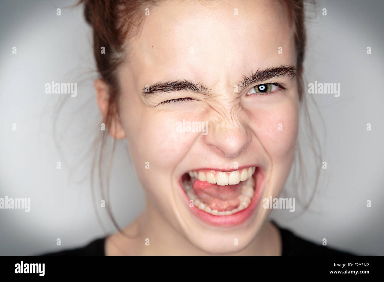 close up portrait of an enthusiastic teenage girl - Stock Image