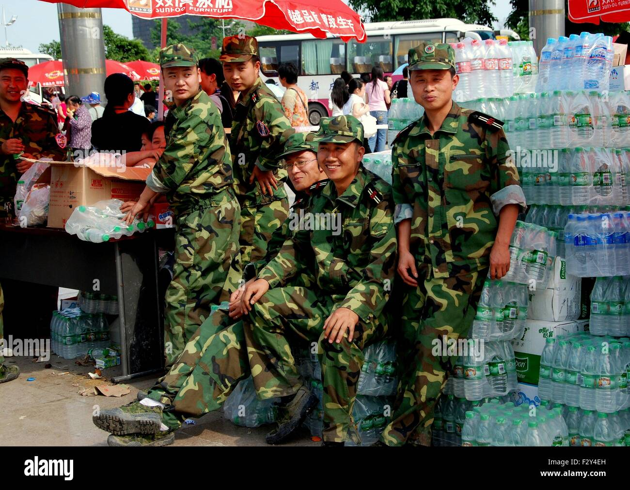 Pengzhou, China:  Chinese soldiers standing with donated bottled water for the victims of the 5-12-08 Sichuan earthquake - Stock Image