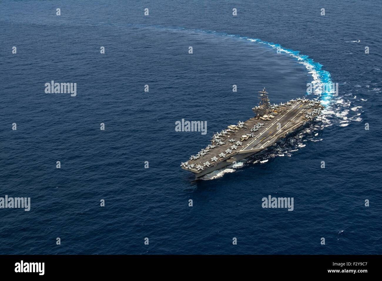 US Navy Nimitz-class nuclear aircraft carrier USS Ronald Reagan underway September 19, 2015 in the Pacific Ocean. - Stock Image