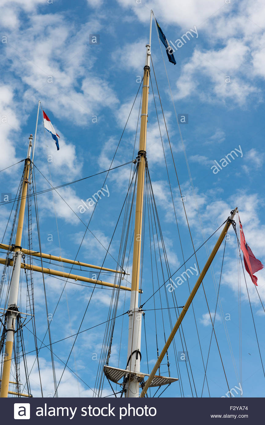 Masts, rigging and flags on the tall ship Glenlee Pointhouse Quay on the River Clyde in Glasgow, Scotland. The ship - Stock Image