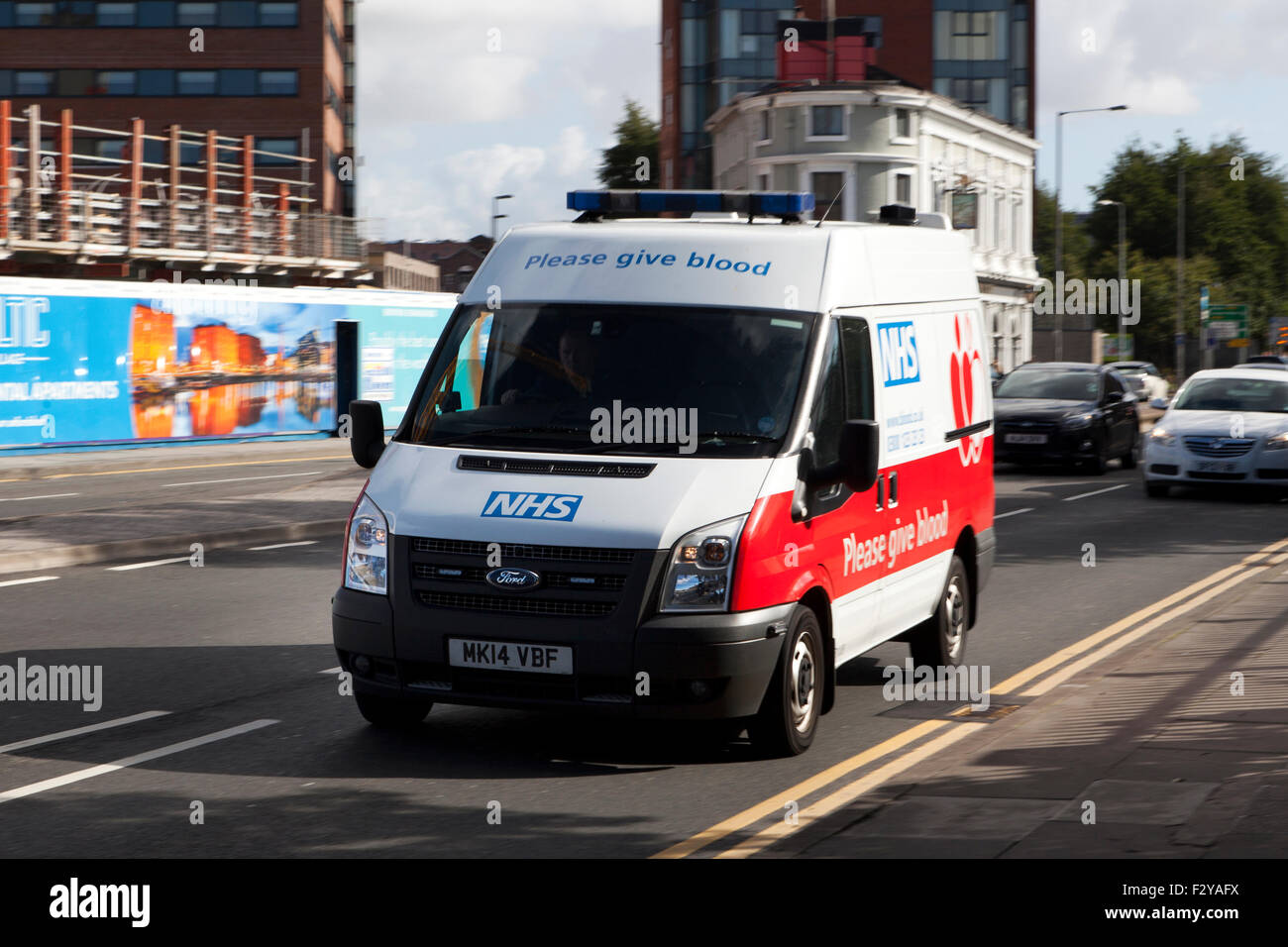 Blurred moving vehicles on 'The Strand' at Liverpool One, Liverpool, Merseyside, UK - Stock Image
