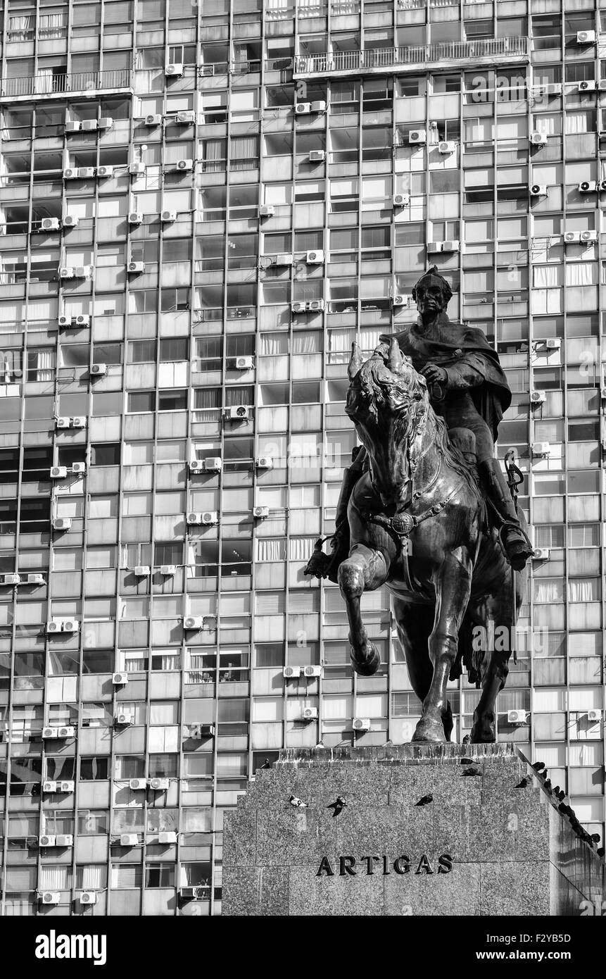 Montevideo downtown scene with the statue of national hero Artigas against the background of high rise buildings - Stock Image