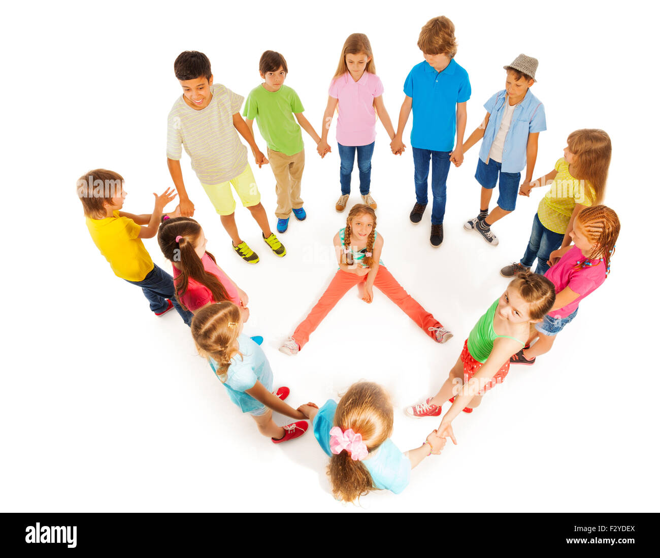 Girl sit on the floor with friends encircle her - Stock Image