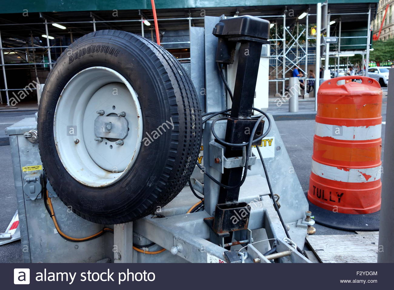 Car tire and street cone barricade in downtown Manhattan - Stock Image